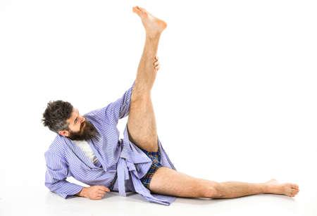 Photo pour Morning exercise concept. Hipster with beard wears bathrobe - image libre de droit