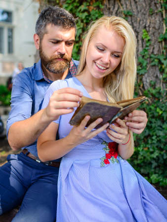 Photo pour Girl with happy face holds old book. Studying and reading - image libre de droit