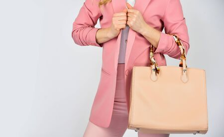 Photo pour need to serve its purpose. woman use leather clutch. girl weal pink formal jacket. confident carry shoulder bag. handbag fashion and beauty. tote or shopper bag for any occasion. copy space. - image libre de droit