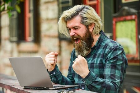 Photo for Living in digital age. Freelancer man working on computer. Businessman using notebook and phone. Escaped of office. successful entrepreneur. happy man sitting in cafe with laptop and checking email - Royalty Free Image