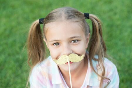 Photo for All the taste of being a girl. Happy girl hold fake mustache outdoors. Child girl with party props. Small girl wear long hair tails. Summer fun. Beauty look. Hair salon. Childhood and girlhood - Royalty Free Image