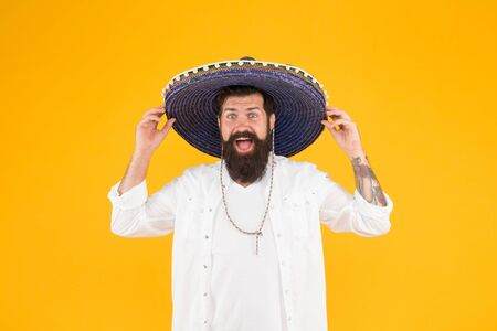 Time to relax. vacation concept at resort in mexico. hipster with beard looks festive in sombrero. happy brutal male celebrating fiesta. guy in poncho. sombrero party man. man in mexican sombrero hat