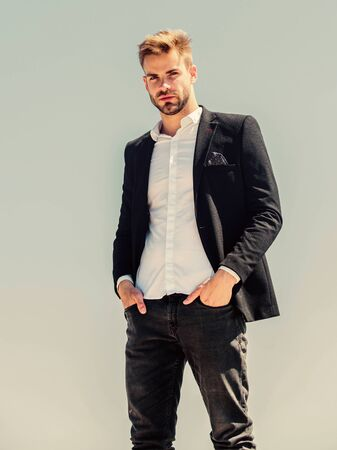 Photo pour Bearded guy business style. sexy macho man. male grooming. formal male fashion. modern lifestyle. confident businessman. Handsome man fashion model. success concept. Sky background. agile business - image libre de droit