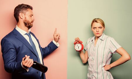 Photo for angry wife. family psychology. unhappy life. man alcoholic drink wine. woman show time on alarm clock. wife wondering why husband reveler came home so late. family routine. problems in relationship - Royalty Free Image
