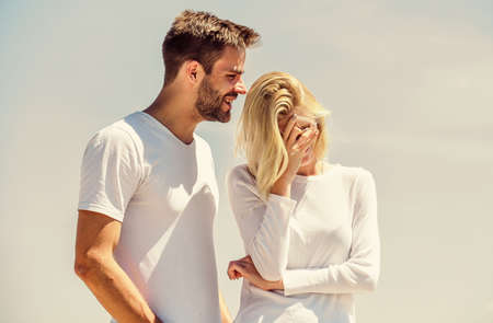 Love story. Man and woman white clothes sunny day outdoors. Communication problems. Summer romance. Family love. True love. Romantic relations. Couple in love blue sky background. Devotion and trust