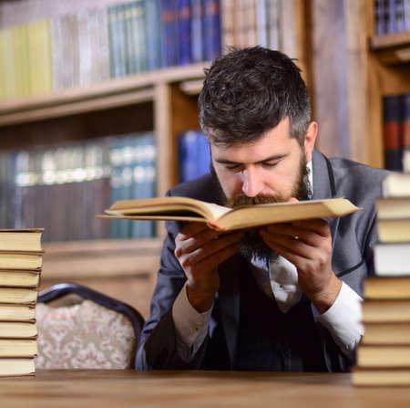 Photo pour Man with beard in classic suit, scientist or professor sniffs - image libre de droit