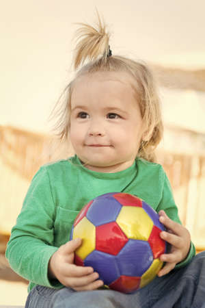 Photo pour small baby boy with happy face sunny summer with ball - image libre de droit