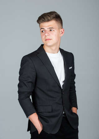 Photo pour fashion model teen. teen boy wear black formal jacket. young businessman. handsome teen male. male barbershop and hairdresser. mens beauty standards. small business owner - image libre de droit