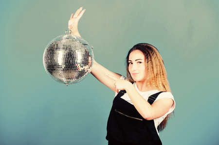 Party invitation. Birthday girl. Mirrors reflecting lights disco atmosphere. Dancing contest. Dancing school. Cheerful woman dancing teacher hold disco ball. How about party. Night club. Retro music