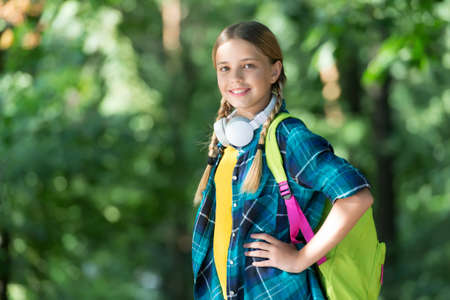 Photo for Happy child carry backpack natural outdoors. - Royalty Free Image