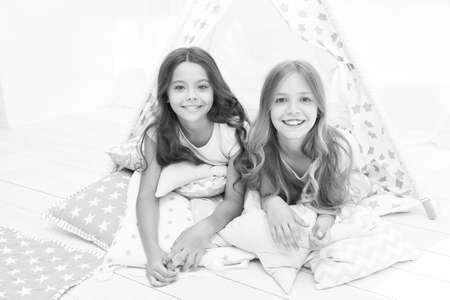 You are beautiful like me. Happy kids relax on cushions. Beauty look of small girls. Beauty and hair salon. Beauty chic. Haircare and skincare products. Home accessories. Beauty lies within us