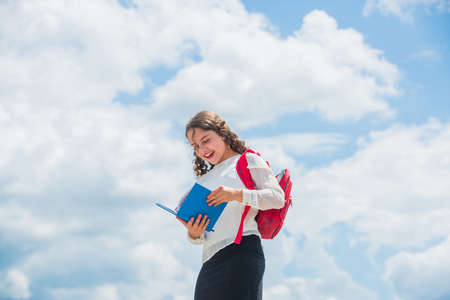 Photo pour Back to school. Little child going to school. Knowledge day. Outdoors classes. Successful schoolgirl. Your chance for successful future. Free education. Happy girl with school backpack sky background - image libre de droit