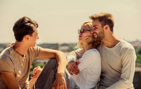 Photo for Friends relaxing on roof. Carefree friends. True friendship. Being sincere with closest people. Men and woman talking sky background. Spending time with friends. Summer vacation. Discussing ideas - Royalty Free Image