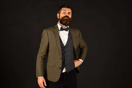 Photo for Man in retro smart suit and vest on brown background. - Royalty Free Image