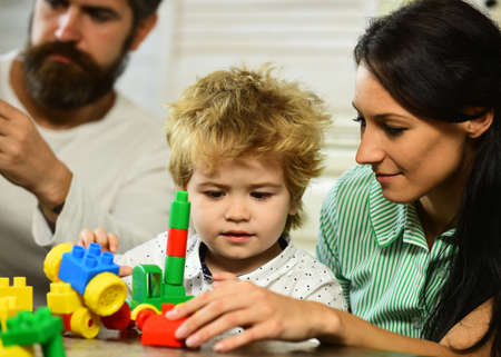 Photo for Family and childhood concept. Parents and son with busy faces - Royalty Free Image