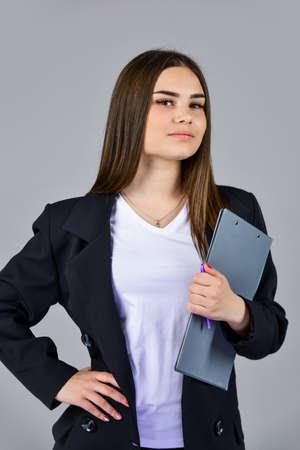 Photo pour Woman wear black suit hold folder documents, hospitable administrative worker concept - image libre de droit