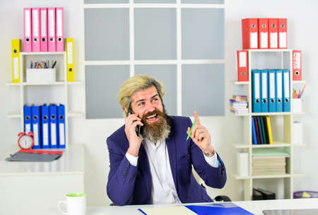 Photo pour what a great idea. chief information officer has phone call. smiling IT director. successful crisis manager make notes in documents. businessman hold office folder. business management professional - image libre de droit