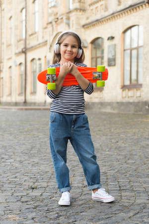 Foto für New adventure awaits. Happy kid hold penny board outdoors. Aboveground transportation. Adventure travel. Childhood activites. Traveling and wanderlust. Summer vacation. Sport and recreation - Lizenzfreies Bild