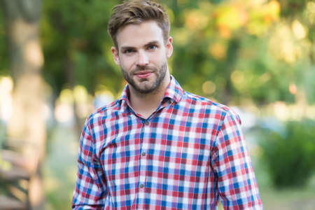 Photo pour young unshaven man outdoor. male beauty and fashion. guy with bristle wear checkered shirt. concept of barbershop. casual fashion style - image libre de droit