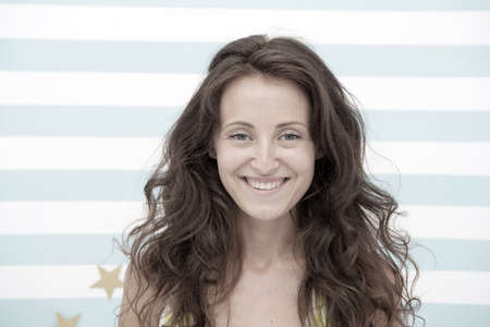 Foto de If we can t do it, no one can. happy woman with wavy hair in hairdresser salon. happy woman has long wavy hairstyle. natural cosmetics for hair. You deserve nothing but the best - Imagen libre de derechos