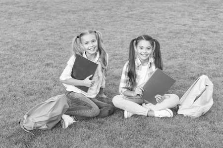 Photo pour having rest after school day. spring holiday time. best friends forever. pass exam with success. funny and happy sisters. writing girlish diary. childhood memories. ready to study - image libre de droit