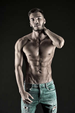 Photo for Check out my shape. Man muscular torso tense muscles veins denim pants. Macho muscular chest looks attractive black background. Athlete with muscular body on confident face proud of his shape - Royalty Free Image