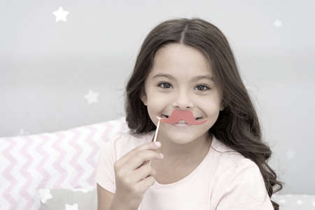 Photo for Having fun with face mustache. Happy small girl. Small girl hold fake mustache on face. Happy childhood. My childhood is amazing - Royalty Free Image