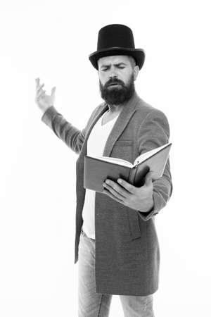 Foto de Literary criticism. Faced with senseless drama. Eloquence and diction. Bearded man read book. Poetry reading. Book presentation. Literature teacher. Books shop. Guy classic outfit read book - Imagen libre de derechos