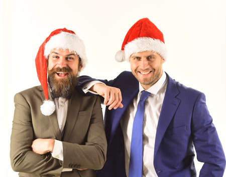 Men in smart suits and Santa hats on white backgroundの素材 [FY310158676835]