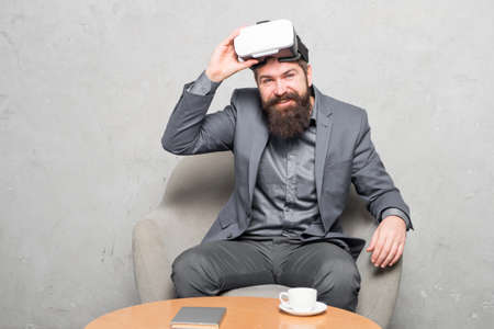 New opportunity. Modern software for business. Business implement modern technology. Business partner interact in virtual reality. Businessman sit chair wear hmd explore virtual reality or ar