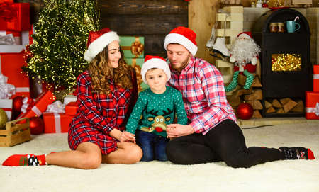 Photo for Portrait loving family. happy family celebrate new year. parents with son wear santa hat. father and mother with child stay home on holidays. merry christmas. mom dad and small kid have fun on party - Royalty Free Image