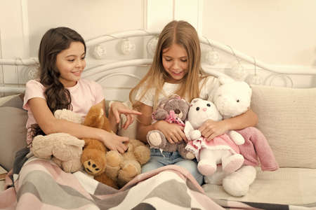 Foto de Best friends forever. Adorable friends play with toys. Small friends enjoy friendship. Little friends in bedroom. Happy childhood. Leisure and playtime. Playing games - Imagen libre de derechos