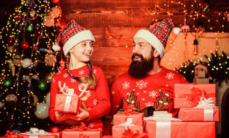 Photo for Father bearded man and daughter near christmas tree. Spend time with family. Dad and child opening christmas gifts. All this is from santa. Happy holidays. Favorite childhood memories of christmas - Royalty Free Image