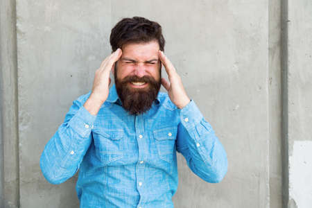 Photo for feel bad. Bearded man. Mature hipster with beard. male facial care. male barber fashion care. brutal man with beard. hispter style. headache and overworking. negative emotions. stressed man - Royalty Free Image