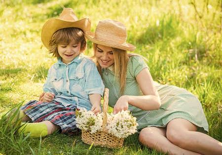 Photo pour Mother and cute son having fun. Spring holiday - image libre de droit