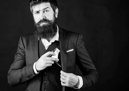 Photo pour Bearded man drink alcohol. brutal caucasian hipster has bad addiction, alcohol. businessman in suit. bachelor and single. Mature hipster with beard put flask in pocket. alcohol srinking. copy space - image libre de droit