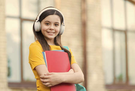 Photo pour Learning foreign language. Small girl learn English. Little child hold English books. Listening comprehension skills. English literature. English grammar. Private lesson. Welcome to language school - image libre de droit