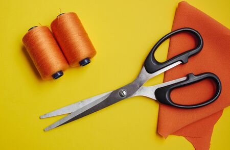 Photo for Scissors and threads on the fabric, top view. Sewing equipment - Royalty Free Image