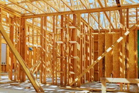 Foto per New construction of a house Framed New Construction of a House Building a new house from the ground up - Immagine Royalty Free