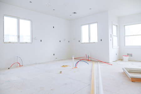Photo pour Interior construction of housing project with drywall installed and patched without building is a new house for the installation - image libre de droit