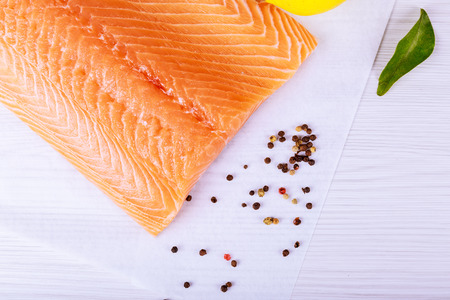 Photo pour Salmon on a wooden board . Selective focus Fish and seafood: Salmon, skin side down - image libre de droit