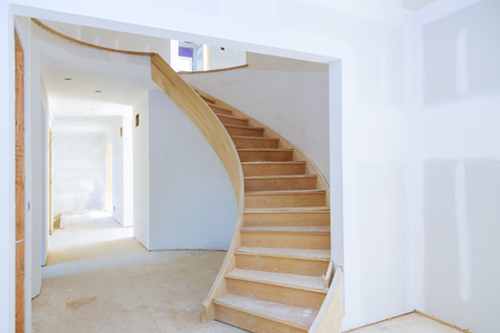 Photo pour Walls of unfinished renovated living room of inside house under construction - image libre de droit