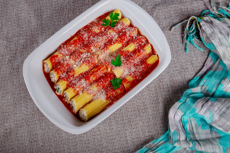 Cannelloni with meat cheese and tomato sauce