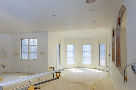 Unfinished apartment interior in new home of construction industry