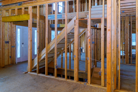 Photo for Home Framing unfinished wood building or a house under construction - Royalty Free Image