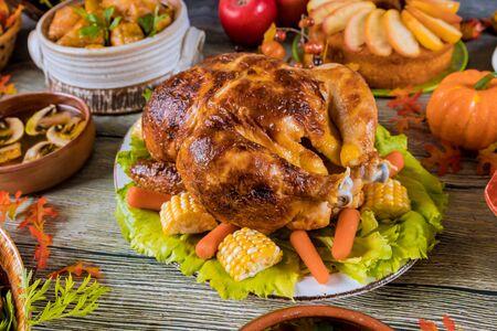Photo pour Thanksgiving dinner table with turkey, apple pie, pumpkin. - image libre de droit