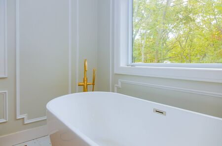 Photo for Luxurious with designer private with large soaking tub installing custom in bathroom joint bathtubs and ceramic tile - Royalty Free Image