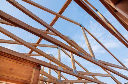 Photo pour Home new wood frame stick built home under construction a blue sky - image libre de droit