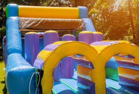 Photo pour Jumps on a big inflatable trampoline castle labyrinth - image libre de droit