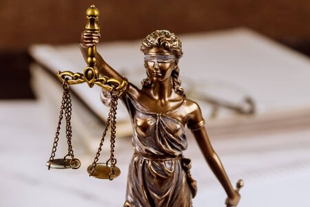 Photo for Statue justice scales law lawyer pile of unfinished documents on law office desk - Royalty Free Image